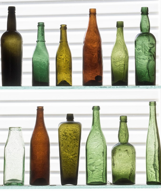 The bottles in this lovely display were found by the home owner in the Wells/Barkerville area. The glass was blown and the bottles made locally during the Gold Rush years. You can see the vintage of the bottles from the amazing swirls in the glass.